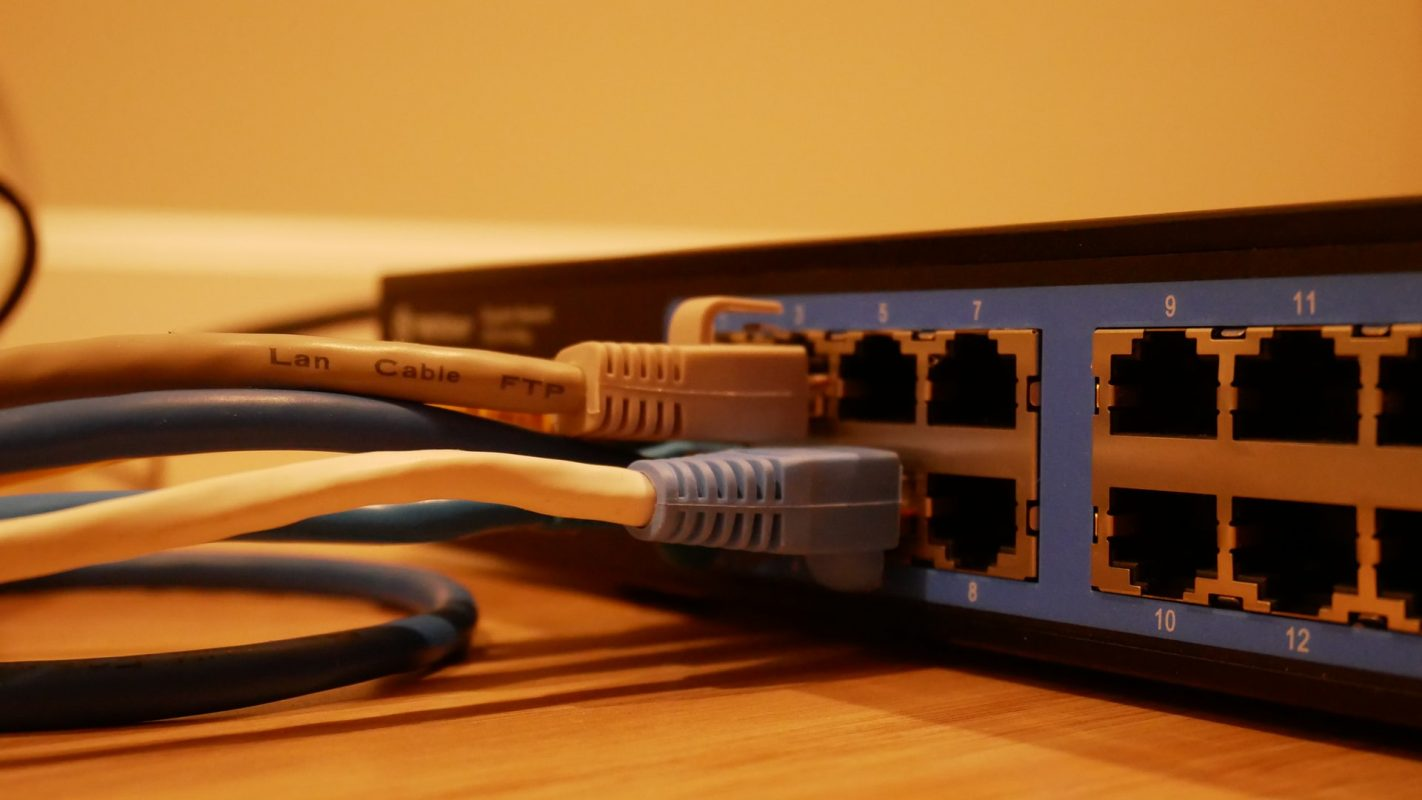 LAN cables running into a wireless router