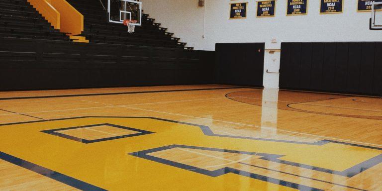 Photo of an empty high school basketball court and gym.